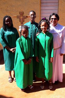 Fr. Saleem Amir with servers at Orange Hill, Jamaica