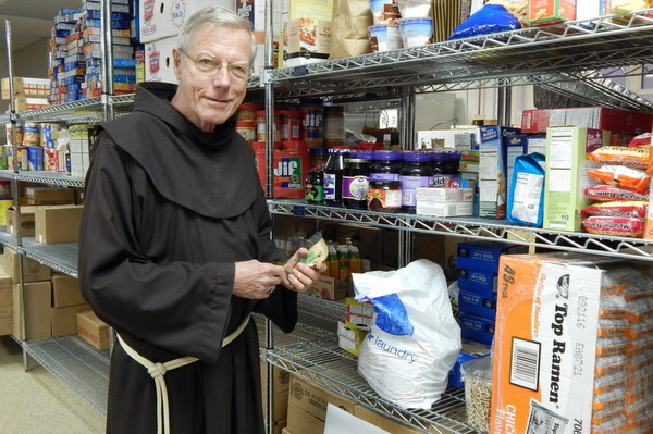 friar in with shelves of food