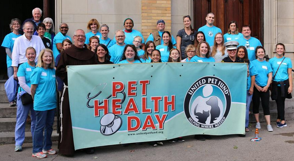 Br. Tim Sucher, OFM, with the doctors and volunteers who made Pet Health Day a reality.