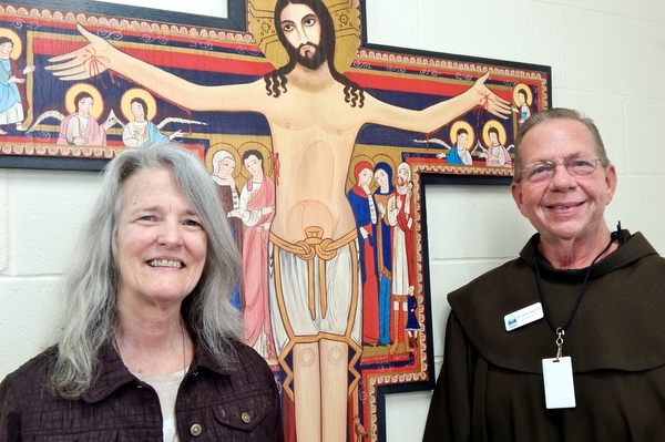 Sr. Ann Marie and Br. David by San Damiano cross