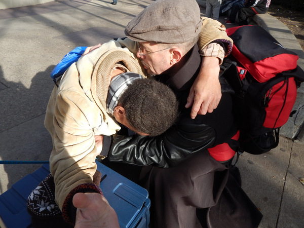 Br. Michael Radomski comforting a man in despair.