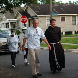 friar and people on street