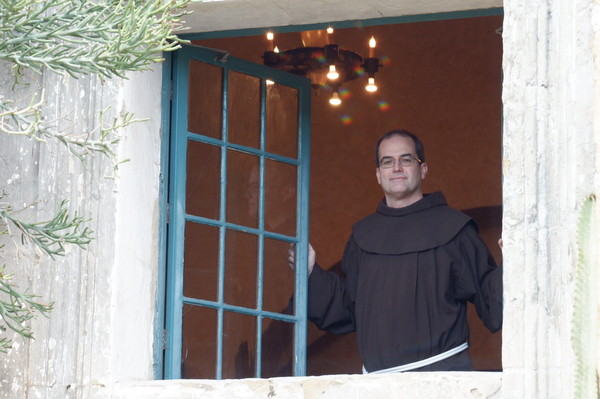 Br. Matt Ryan looks out a window at the Franciscan International Novitiate in Santa Barbara