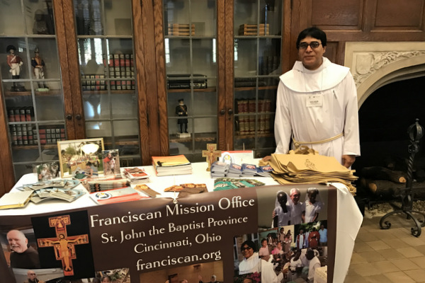 Fr. Saleem Amir, OFM, at SJB's information table for a Missionary Conference held in Cincinnati, Ohio