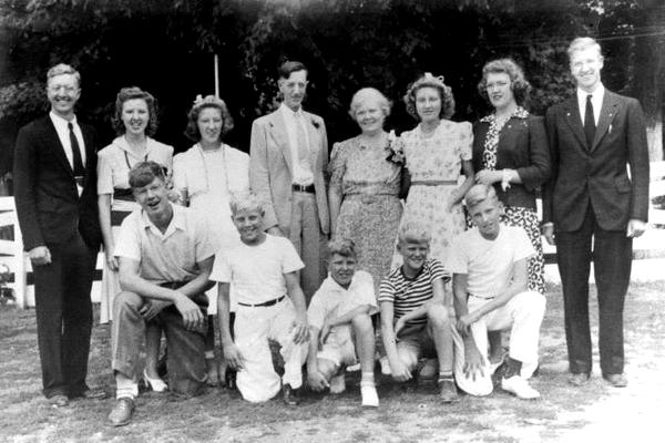 The Schneider family on the occasion of Otto and Anna's 25th wedding anniversary in 1941. Top row L-R: Victor (Fr. Bernardin, OFM) Marcella,  Jeannette, Otto, Anna, Cecilia, Dorothy, Bertrand (Fr. Chris, OFM), Kenneth, Norbert, Raymond (Fr. Ric, OFM), Donald, Robert (Fr. Aquinas, OFM)