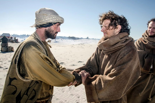 Sultan and St. Francis shake hands in the Egyptian desert.