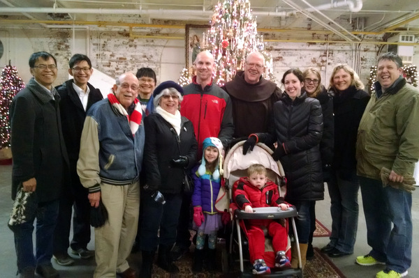 Br. Tim Sucher surrounded by families visiting the Franciscan Christmas at the Christian Moerlein Event Center
