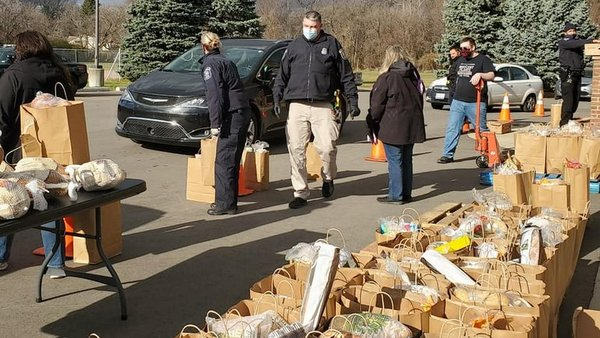 people and bags of groceries