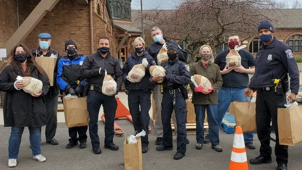 police with bags of food