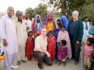 Custos Yusuf Bagh (far left) with Br. vince Delorenzo (far right) and Fr. Alex Kratz (kneeling) with parishioners in Karachi, Pakistan.