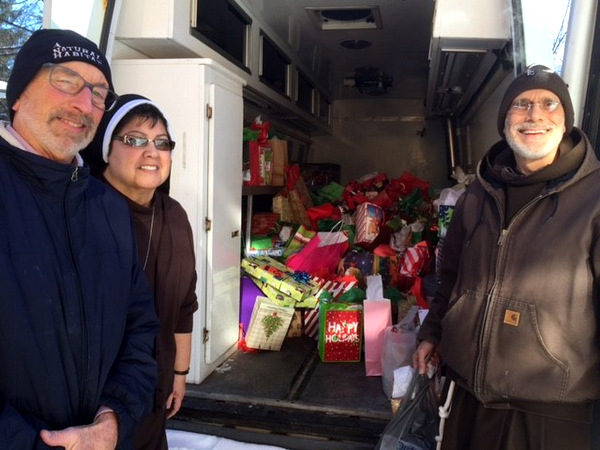 Volunteer Tom Grassa, Sr. Francesca, and Br. Al Mascia filled the Care'avan with hundreds of useful items to be turned into CarePax and distributed on the streets of Detroit