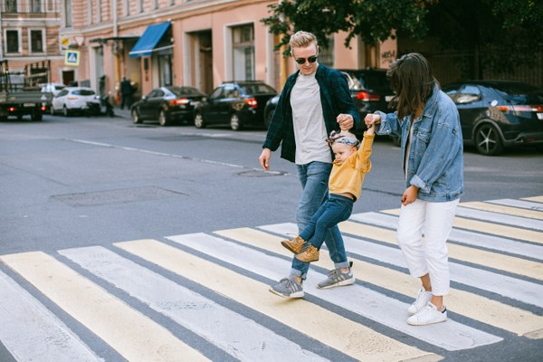 couple with child crossing street